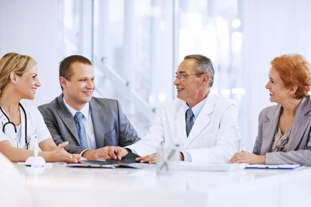 Doctor Collaborating with a Business Team.